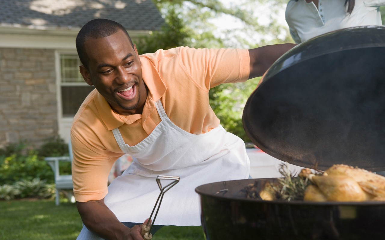 Man_grilling_outside_page-bg_10595